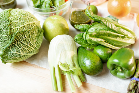 Green raw vegetables on the kitchen table Stock Photo
