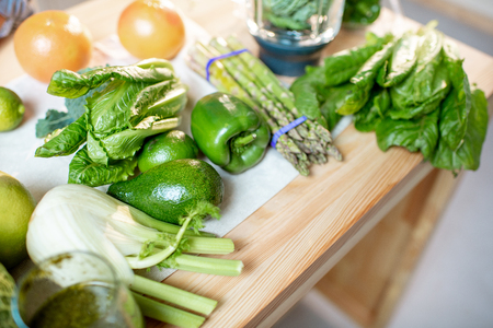 Green raw vegetables on the kitchen table Standard-Bild - 114134337