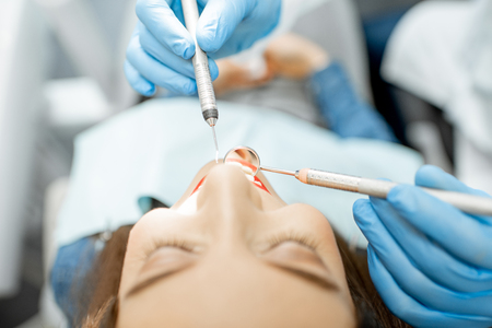 Close-up view on the womans face during the dental examination Zdjęcie Seryjne
