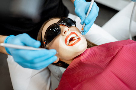 Close-up of a womans face during the professional dental examination