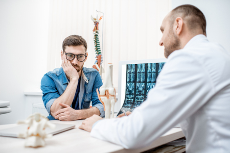 Man with sad emotions during the medical consultation at the therapist office