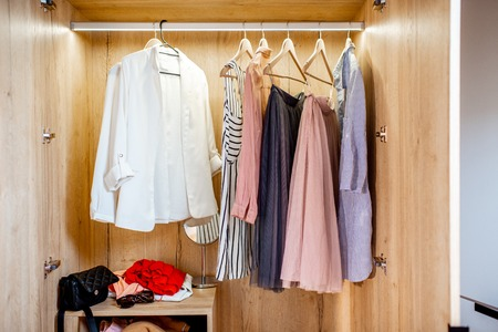 Wardrobe full of female clothes and shoes at home Stok Fotoğraf