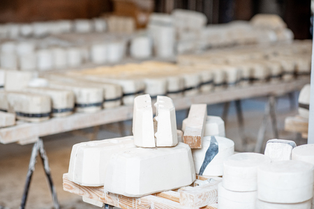 Gypsum forms for ceramic production at the pottery manufacturing Stock Photo