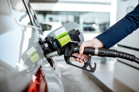 Man refueling car with gasoline, close-up view focused on the filling gun Reklamní fotografie