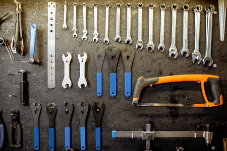 Wall with different working tools and wrenches for bicycle repairing