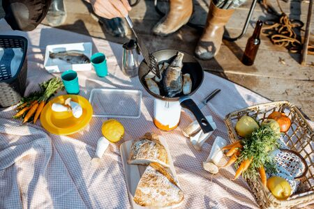 Beautiful picnic with fresh caught fish and vegetables 写真素材 - 125572058
