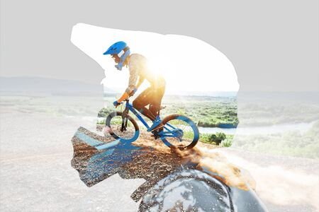 Double exposure of a man in protective helmet and professional cyclist riding on the mountains. Concept of a freeride and off road cycling Reklamní fotografie