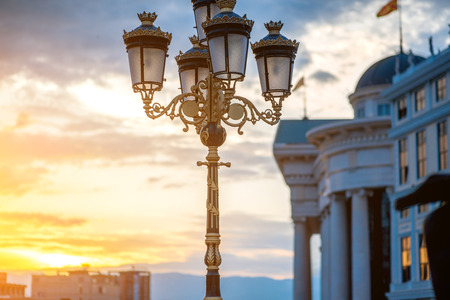Beautiful lantern on Art bridge with national museum on background in Skopje on sunset