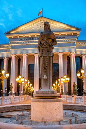 Maria Teresa monument with National museum on background in Skopje with evening lights Editorial