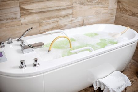 Hydromassage tub filled with water ready for use in the SPA room Stok Fotoğraf