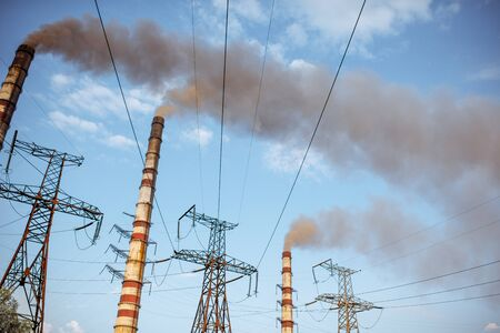 Air pollution from the old power plant heat working on coal