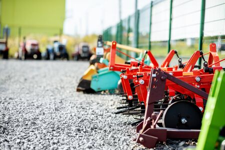 New plows for farming on the open ground of agricultural shop