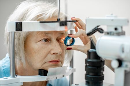 Senior woman during a medical eye examination with microscope in the ophthalmologic office, close-up