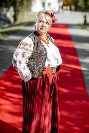 Portrait of a woman dressed in Ukrainian national dress as a well-known actress on the red carpet during awards ceremon