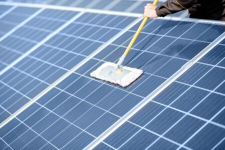 Close-up of professional cleaning of solar panels with a mob. Concept of solar power plant cleaning service Stock fotó