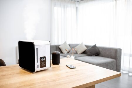 Working air humidifier on the table in the living room. Home air humidification concept