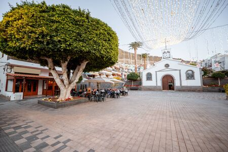 View on a central square with old church in Los Gigantes village on a twilight. Tenerife island, Spain