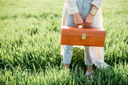 Woman with beautiful handbag on the greenfield Reklamní fotografie