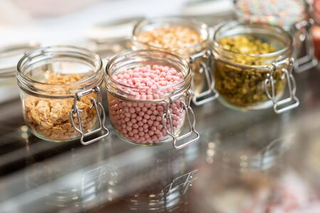 Various food additives in the form of topping for ice cream, close-up