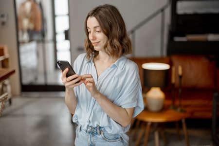 Woman using Smartphone in living room