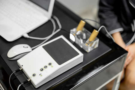 Bioenergetic testing device with brass handpieces in medical clinic