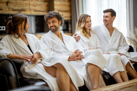 Woman and male in bathrobe in spa