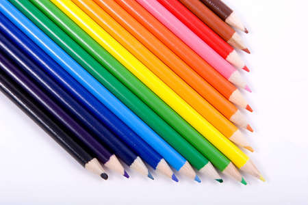 Colored Pencils lined up in an arrow arrangement