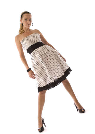 Young blond in a polka dot dress