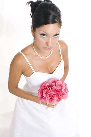 Bridal portrait over white background with flowers Imagens