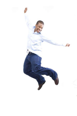 Young man jumping in the air over white background