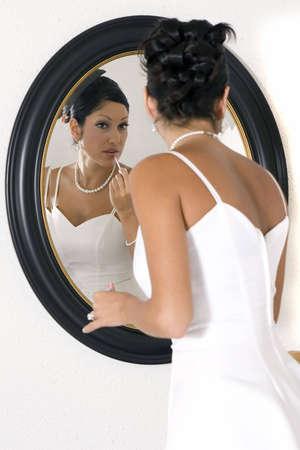 Bridal looking in mirror
