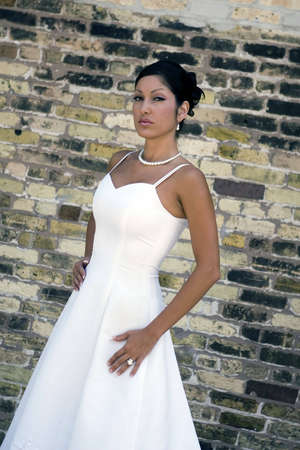 Bridal portrait outdoor with brunette in wedding dress photo