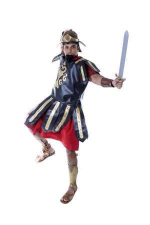 Adult Male Indian Model dressed as Roman Soldier over white background Stock fotó