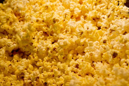 buttered: Buttered Theater popcorn under yellow light Stock Photo