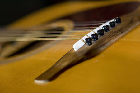 Close up of one end of a string guitar