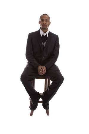 stool: Adult African American Male in Business suit over a white background