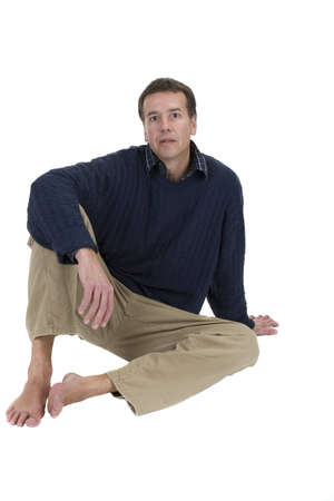 Adult male model in sweater sitting over white background Imagens