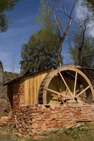 Old Waterwheel against a blue sky