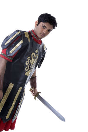 Adult Male Indian Model dressed as Roman Soldier over white background Imagens