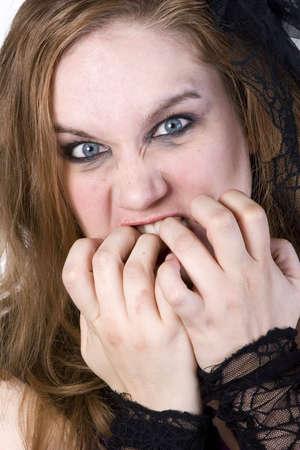 Brunette Model in Goth clothing over white background Imagens - 6210602