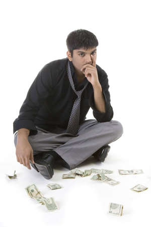 Male model with cash over white background Imagens