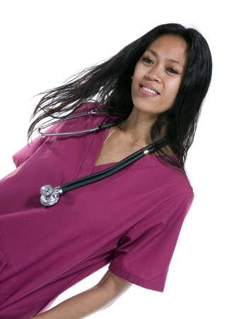 Brunette in medical scrubs over white background Imagens - 8278455
