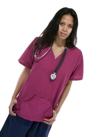 Brunette in medical scrubs over white background Stock Photo - 8278452