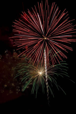 Red and Green Firework Bursts during holiday celebration Imagens