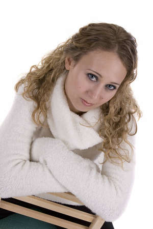 Young Woman in white Sweater over a white background Imagens
