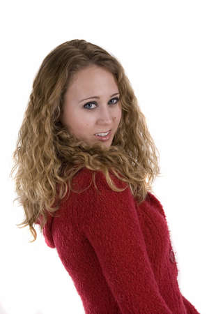 Young woman in red sweater over white background Imagens