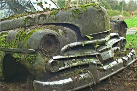 rusts: OLD CHRYSLER  MOSSY FRONT END Stock Photo