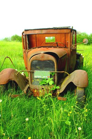 OLD TRUCK BODY IN THE FEILD photo