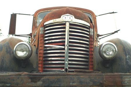 OLD RUSTED TRUCK AT THE GRAVEL PIT photo