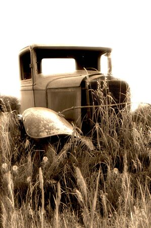 OLD TRUCK IN THE GRASS-sepiaglow photo